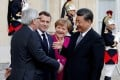 Welcoming Chinese President Xi Jinping are (from left) European Commission President Jean-Claude Juncker, French President Emmanuel Macron and German Chancellor Angela Merkel, at the Elysee Palace in Paris on March 26. The EU, pushed by France and Germany, wants more reciprocity in its trade and investment engagement with China. Photo: Reuters