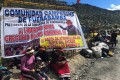 Demonstrators block a road to a Chinese copper mine in Fuerabamba, Peru. Photo: Reuters