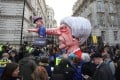 An effigy of Britain's Prime Minister Theresa May spearing a representation of the British economy is positioned outside Downing Street during a rally organised by the pro-European People's Vote campaign, calling for a second EU referendum on March 23, 2019. Photo: AFP