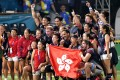 Hong Kong's men celebrate their gold medal triumph over Japan at the Asian Games in Jakarta. The women lost in the quarter-finals to Thailand. Photo: AFP