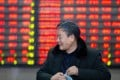 An investor at a stock exchange in Nanjing, capital of east China's Jiangsu province on March 4, 2019. Contrary to global conventions, China's stock market denotes gains and advances in red, and represents losses and declines in green. Photo: Xinhua