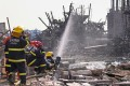 Firefighters at work in the rubble of the chemical plant. Photo: Reuters