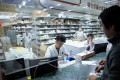 Staff at work in the pharmacy of the Yueyang Hospital, part of the Shanghai University of Traditional Chinese Medicine, in Shanghai. Photo: AFP