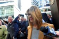 Lori Loughlin leaves the federal courthouse after facing charges in a nationwide college admissions cheating scheme in Boston, Massachusetts, on Wednesday. Photo: Reuters