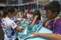 Hong Kong women's players Sham Wai-sum and Melody Li sign autographs for fans on the first day of the Sevens at Hong Kong Stadium. Photo: Jonathan Wong