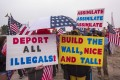 Supporters of US President Donald Trump rally for the president during his visit to see the controversial border wall prototypes on March 13, 2018 in San Diego, California. The border visit is Trump's first trip to California since taking office. Photo:: Getty Images/AFP