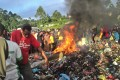 Purported to be the burning rubbish pile on Warakum Junction Road, in Mount Hagen, Papua New Guinea, on to which 20-year-old Kepari Leniata was thrown in 2013. Photo: AFP