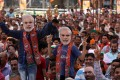 Supporters wearing Prime Minister Narendra Modi masks cheer as they attend a rally of his ruling Bharatiya Janata Party, near Jammu on April 3. Photo: EPA-EFE