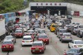 Vehicles jostle to enter the Eastern Harbour Tunnel from Kowloon to Hong Kong Island during the morning rush hour. Photo: Edmond So