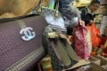Paper Chanel handbags for sale at a shop in Sai Ying Pun for Ching Ming festival. Photo: Felix Wong