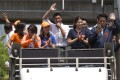 Thailand's Future Forward Party leader Thanathorn Juangroongruangkit thanking people for their support from the top of a vehicle in Bangkok on April 3, 2019. Photo: AP
