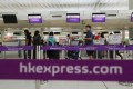 Passengers check in at Hong Kong International Airport. Photo: SCMP Pictures