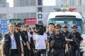 Guangdong provincial police hand over three suspects in a robbery case to Hong Kong Police at Huanggang port in August 2018. Photo: Edward Wong