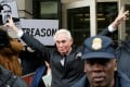 Roger Stone, long-time political ally of US President Donald Trump, flashes a victory gesture as he departs following a status conference in the criminal case against him brought by Special Counsel Robert Mueller at US District Court in Washington on February 1. Photo: Reuters