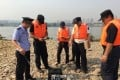 About 100 police officers, fisheries officials and members of the public helped round up the liberated snakes. Photo: Weibo