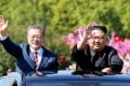 South Korean President Moon Jae-in and North Korea's Kim Jong-un wave during a parade in Pyongyang on September 18, 2018. Photo: Reuters