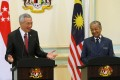 Singapore's Prime Minister Lee Hsien Loong with Malaysia's Prime Minister Mahathir Mohamad in Putrajaya. Photo: Reuters