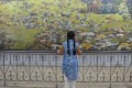 An Indian girl looks at a painting of the martyrs ahead of the 100th anniversary of the Jallianwala Bagh massacre in Amritsar. Photo: AFP