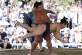 "Sumo wrestlers perform a show fight during the annual ""Honozumo"" ceremonial sumo tournament in Tokyo on April 18, 2016. Photo: Reuters"