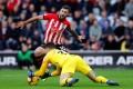 Southampton's Charlie Austin (10) in action with Manchester City's Ederson in December 2018. Photo: Reuters