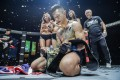 Martin Nguyen celebrates back in 2017 when lifting his second title, the One lightweight crown. Photos: One Championship