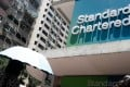 Standard Chartered agreed to pay US$1.1 billion to settle long-running investigations. Photo: Bloomberg