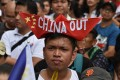 Protesters march in front of the Chinese consular office in Manila. Photo: AFP
