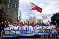 Activists and opposition leaders protest over the presence of Chinese vessels in the South China Sea at the Chinese embassy in Makati City, Philippines. Photo: Reuters