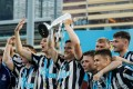 Newcastle United celebrate winning the Main Tournament Cup Final at the HKFC Citi Soccer Sevens 2018. Photo: Yu Chun Christopher Wong/Power Sport Images