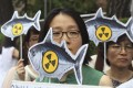 Environmentalists stage a rally denouncing imported agricultural and marine products from Japan. Photo: AP