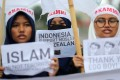 Indonesian Muslim students show their support for victims of the mosque shootings in New Zealand. Photo: EPA-EFE/Bagus Indahono