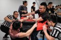 Participants competing in the 7th Shanghai Arm Wrestling Open in Shanghai. Photo: AFP