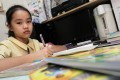 A recent survey found that almost every primary school student in Hong Kong spends an hour or more on homework every day. Photo: K.Y. Cheng