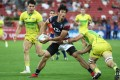 Hong Kong's Salom Yiu in action against Australia at the Singapore Sevens. Photo: HKRU