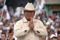 Prabowo Subianto greets supporters in Palembang, south Sumatra. Photo: Bloomberg