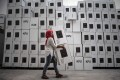 An Indonesian election commission worker arranging ballot boxes in Surabaya. Photo: AFP