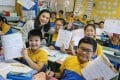 The principal and students at a Tai Po school celebrate freeing up afternoon lessons so children can complete their homework in class and not bring work home, in October 2018. Photo: K.Y. Cheng