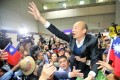 Fans greet Kaohsiung mayor Han Kuo-yu on his return to Taiwan on Thursday after his trip to the United States. Photo: CNA