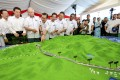 Malaysian officials including former prime minster Najib Razak (third from left) look at a model of the proposed East Coast Rail Link in September 2017. Photo: AP