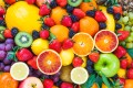 Have an orange with your scrambled tofu, an apple with your almonds, a juicy peach for dessert. You'll be happier – and healthier, says registered dietitian nutritionist Carrie Dennett. Photo: Shutterstock