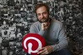Evan Sharp, Pinterest co-founder and chief product officer, poses for a photo in his office beside a wall of pinned photos he has taken at Pinterest headquarters in San Francisco. Photo: AP