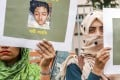 Bangladeshi women hold placards and photographs of schoolgirl Nusrat Jahan Rafi at a protest in Dhaka, following her murder. Photo: AFP