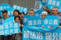 Supporters of the government's plan to amend the Fugitive Offenders Ordinance and the Mutual Legal Assistance in Criminal Matters Ordinance call for justice and the rule of law to be upheld, in Admiralty on April 17. Photo: Dickson Lee