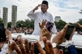 Prabowo Subianto gestures to supporters as he leaves a mosque after Friday prayers in Jakarta. Photo: AFP
