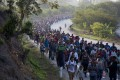 Central American migrants, part of a caravan hoping to reach the US border, move on the road in Escuintla, Chiapas State, Mexico. Photo: AP Photo