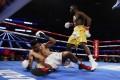 Terence Crawford knocks down Amir Khan. Photo: Reuters