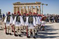 Presidential guards present arms in front of the Parthenon temple during the ceremony for the annual anniversary of the liberation of Athens from Nazi occupation, at the Acropolis Hill, in Athens. Photo: EPA