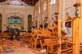 Sri Lankan soldiers inspect damage inside St. Sebastian's Church where a bomb blast took place. Photo: Bloomberg