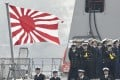A Japanese Maritime Self-Defence Force ensign is flown on the deck of the destroyer Suzutsuki as it arrived at China's Qingdao port on April 21. Photo: Kyodo