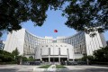 China's central bank has not yet collected any utilities data, although the new system will have the ability to add data concerning water, power and telecommunication bills. Photo: Reuters